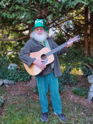 Doug as St. Paddy Playing Guitar