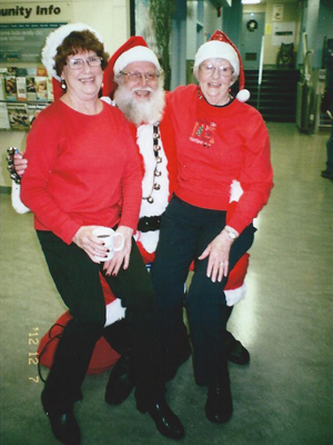 Santa with a lap full of ladies